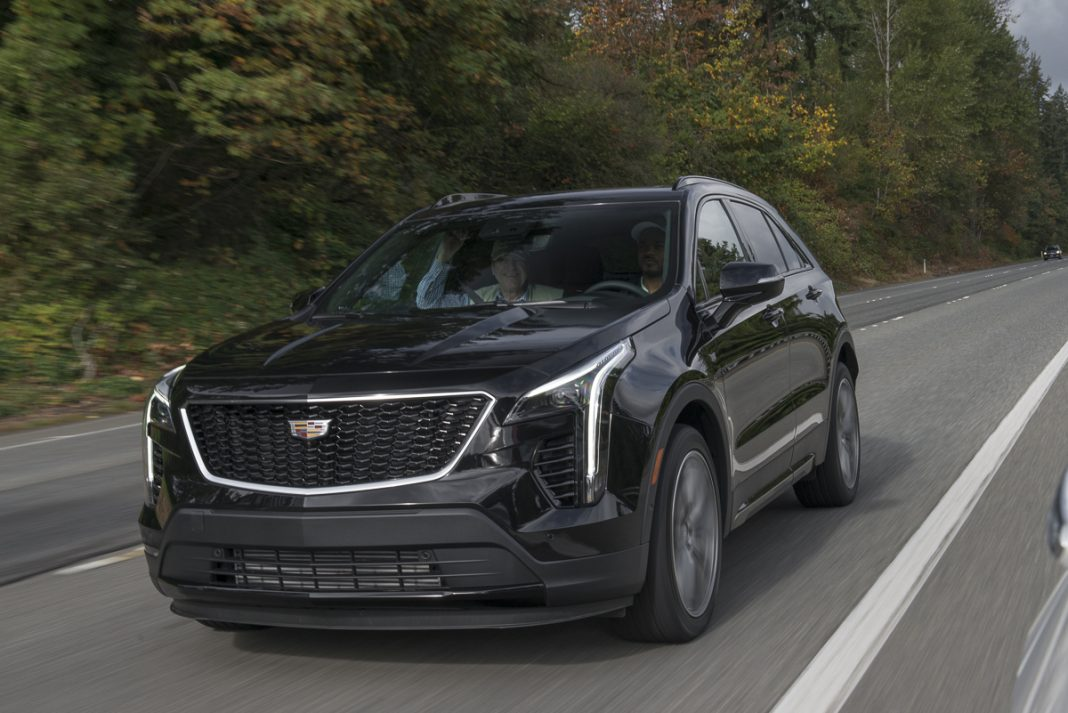 2019 Cadillac XT4 in black rolling down road