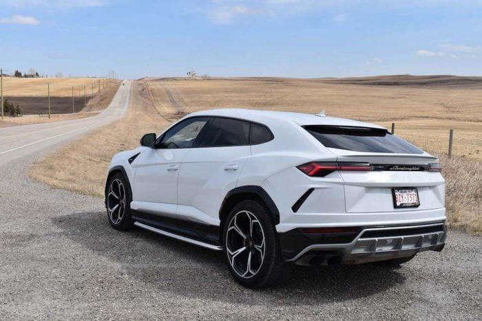 2019 lamborghini urus rear view in white