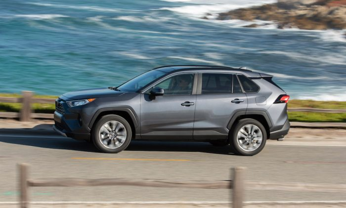 2019 Toyota RAV4 Limited driving on the road by the beach