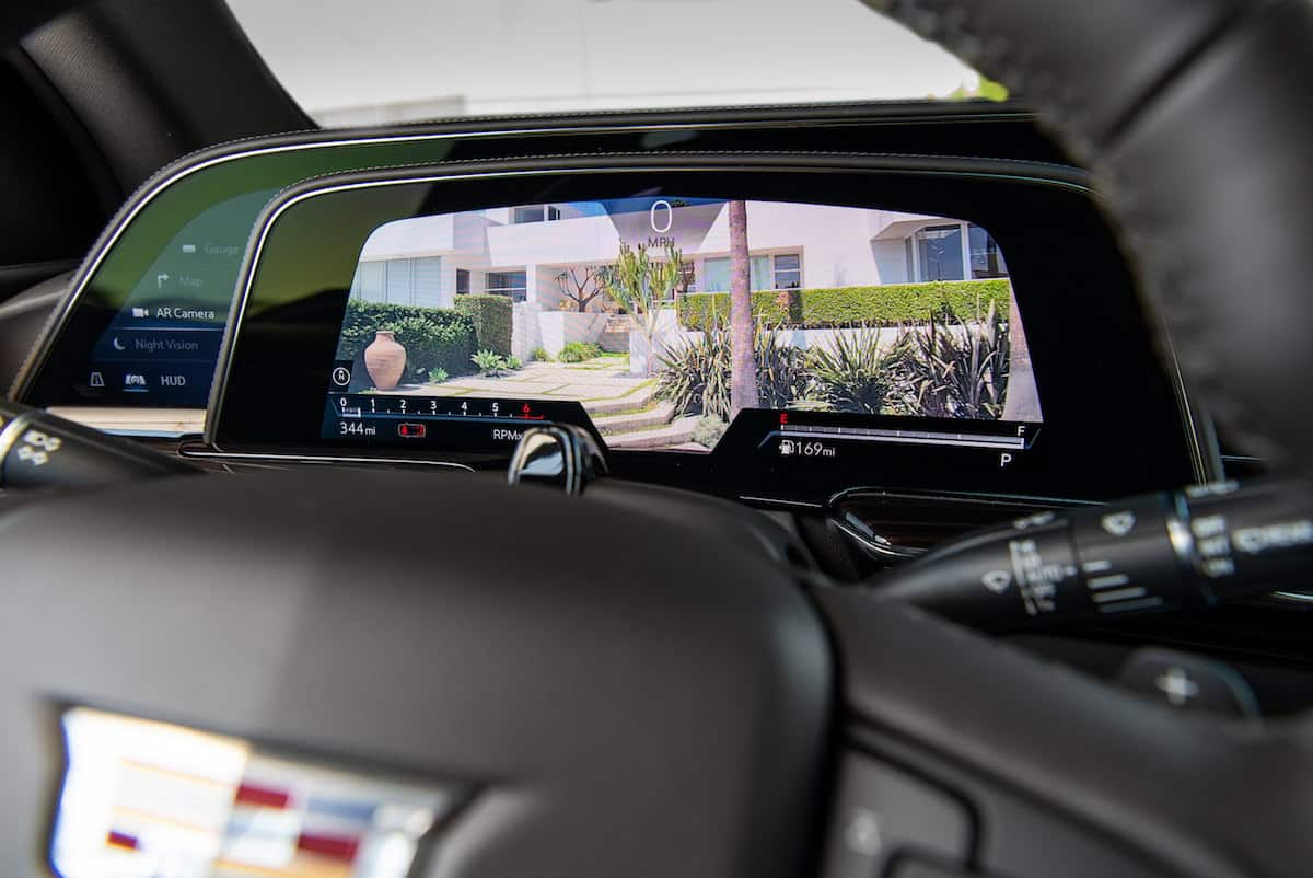 """The 2021 Cadillac Escalade features a 14.2"""" diagonal cluster display with two reconfigurable zones for vehicle information and different four layouts, including: gauge view, augmented reality with active route navigation, map navigation, and available night vision."""